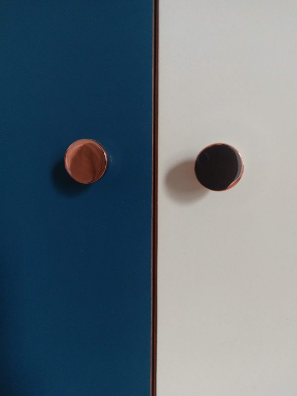 copper knobs on mid-century sideboard
