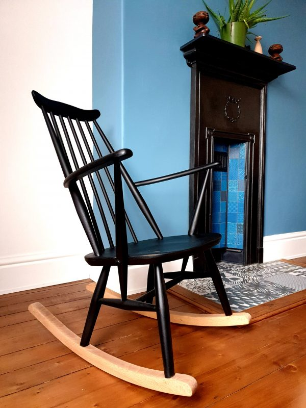 Ercol goldsmith rocking chair by fireplace