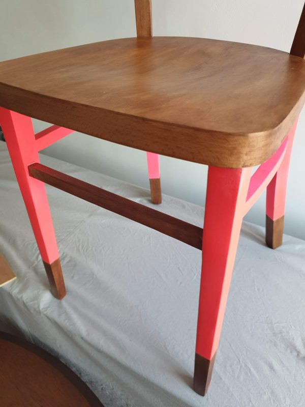 detailing of the vintage fluorescent pink dining chair